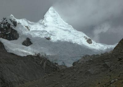 Alpamayo revealed in wild weather